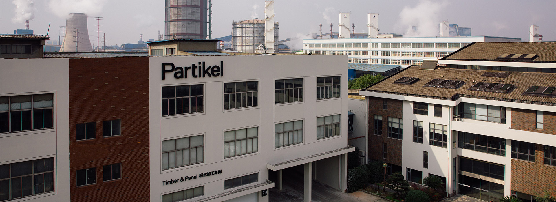 Photograph of Partikel building with Patikel logo